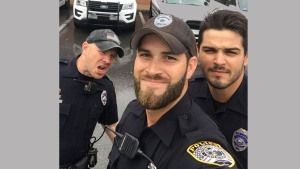 In this Sunday, Sept. 10, 2017, photo provided by the Gainesville Police Department, officers, from left, John Nordman, Michael Hamill and Dan Rengering take a selfie in Gainesville, Fla. The photo was widely-shared on social media after the department posted it to Facebook with comments praising the officers good looks. (Gainesville Police Department via AP)