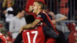 Toronto FC forward Sebastian Giovinco (10) celebrates his goal against the Philadelphia Union with teammates Jozy Altidore (17) and Victor Vazquez (7) during first half MLS soccer action in Toronto on Wednesday, August 23, 2017. THE CANADIAN PRESS/Nathan Denette