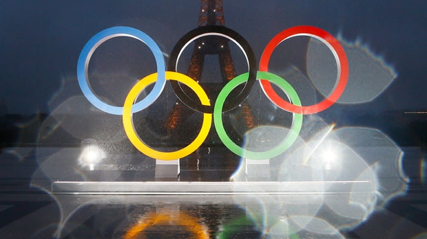 In this photo taken with a lens with rain drops shows the reflection of the Olympic rings on Trocadero plaza that overlooks the Eiffel Tower, after the vote in Lima, Peru, awarding the 2024 Games to the French capital, in Paris, France, Wednesday, Sept. 13, 2017. Paris will host the 2024 Summer Olympics and Los Angeles will stage the 2028 Games — a pre-determined conclusion that the International Olympic Committee has officially ratified in a history-making vote. (AP Photo/Francois Mori)