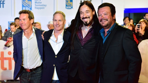 "The Tragically Hip, from left, Gord Sinclair, Johnny Fay, Rob Baker and Paul Langlois arrive on the red carpet for the movie ""Long Time Running"" during the 2017 Toronto International Film Festival in Toronto on Wednesday, September 13, 2017. THE CANADIAN PRESS/Frank Gunn"
