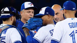 Toronto Blue Jays starting pitcher Marcus Stroman, centre, is visited on the mound by manager John Gibbons, second left, and trainer George Poulis, second right, during sixth inning AL baseball action against the Baltimore Orioles in Toronto on Wednesday, September 13, 2017. THE CANADIAN PRESS/Nathan Denette