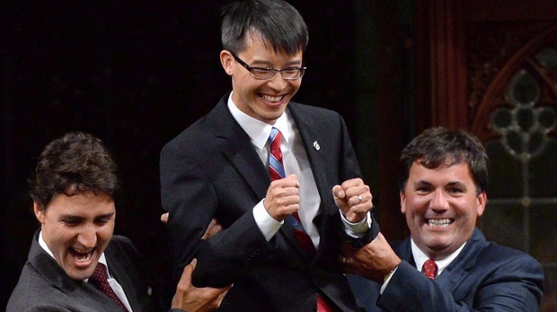 Liberal Leader Justin Trudeau and MP Dominic LeBlanc (right) escort new Liberal MP Arnold Chan in the House of Commons, Monday, Sept. 15, 2014 in Ottawa. THE CANADIAN PRESS/Sean Kilpatrick