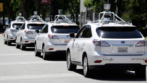 This May 13, 2014, file photo shows a row of Google self-driving Lexus cars at a Google event outside the Computer History Museum in Mountain View, Calif. (AP Photo/Eric Risberg, File)