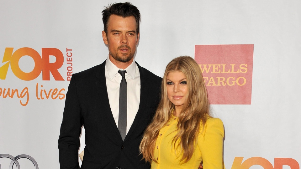 Josh Duhamel, left, and Fergie arrive at TrevorLIVE Los Angeles Benefit at the Hollywood Palladium, on Sunday, December, 8, 2013 in Los Angeles, Calif. (Photo by Richard Shotwell/Invision/AP)