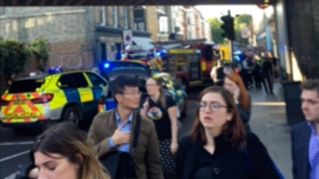 "People leave the scene of an explosion at a southwest London subway station in London Friday, Sept. 15, 2017. London's Metropolitan Police and ambulance services are confirming they are at the scene of ""an incident"" at the Parsons Green subway station in the southwest of the capital. The underground operator said services have been cut along the line. (@RRIGS via AP)"