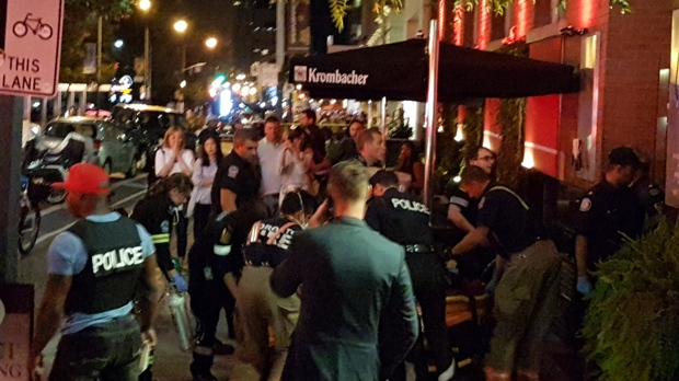 Paramedics work to revive a shooting victim outside Michael's on Simcoe on Sept. 16, 2017. (Chris Herhalt/CP24)