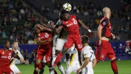 Toronto FC's Tosaint Ricketts, center right, heads the ball in front of Los Angeles Galaxy's Gyasi Zerdes during the second half of an MLS soccer match Saturday, Sept. 16, 2017, in Carson, Calif. Toronto FC won 4-0. (AP Photo/Jae C. Hong)
