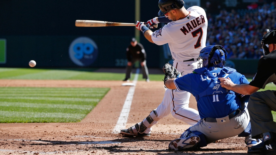 Minnesota Twins' Joe Mauer drives in two runs as he grounds into a fielder's choice off Toronto Blue Jays pitcher Time Mayza in the second inning of a baseball game Sunday, Sept. 17, 2017, in Minneapolis. (AP Photo/Jim Mone)