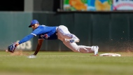 Toronto Blue Jays shortstop Richard Urena makes a futile attempt for the wide throw as Minnesota Twins' Eduardo Escobar steals second base in the fifth inning of a baseball game Sunday, Sept. 17, 2017, in Minneapolis. (AP Photo/Jim Mone)