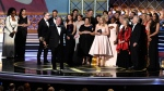 "Bruce Miller and the cast and crew accept the award for outstanding drama series for ""The Handmaid's Tale"" at the 69th Primetime Emmy Awards on Sunday, Sept. 17, 2017, at the Microsoft Theater in Los Angeles. (Photo by Chris Pizzello/Invision/AP)"