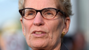Ontario Premier Kathleen Wynne talks to media after appearing as a witness in the Election Act bribery trial in Sudbury, Ontario, Wednesday, Sept. 13, 2017. Ontario's premier and Opposition leader are sticking to their guns in a dispute that could lead to legal action. THE CANADIAN PRESS/Sean Kilpatrick