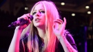 In this Dec. 13, 2013 file photo, Avril Lavigne performs in concert during the Mix 106.5 Mistletoe Meltdown at SECU Arena Towson University in Towson, Md. (Photo by Owen Sweeney/Invision/AP, File)