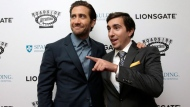 """Actor Jake Gyllenhaal, left, and Boston Marathon bombing survivor Jeff Bauman, right, arrive on the red carpet Tuesday, Sept. 12, 2017, at the U.S. premiere of the movie """"Stronger"""" at the Spaulding Rehabilitation Hospital, in Boston. The U.S. premiere of the film that chronicles the story of Bauman is to take place at the hospital where he and others who were injured in the 2013 deadly attack were treated. Gyllenhaal plays Bauman in the film. (AP Photo/Steven Senne)"""