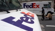 In this Tuesday, Aug. 22, 2017, photo, FedEx trucks are parked in New York. FedEx Corp. reports earnings, Tuesday, Sept. 19, 2017. (AP Photo/Mark Lennihan)