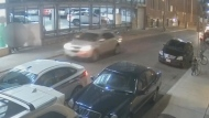 A getaway vehicle, believed to be an SUV, is shown fleeing on Pearl Street on Sept. 16 in a surveillance camera image. (TPS)