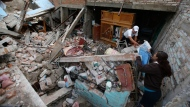 Residents salvage personal items from a home destroyed in a 7.1 earthquake, in Jojutla, Morelos state, Mexico, Wednesday, Sept. 20, 2017. (AP Photo/Eduardo Verdugo)