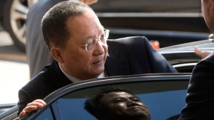 """FILE - In this Sept. 19, 2017, file photo, North Korean Foreign Minister Ri Yong Ho gets into a car at Beijing Capital International Airport in Beijing. Ri in New York on Wednesday, Sept. 20, 2017, described as """"the sound of a dog barking"""" U.S President Donald Trump's threat to destroy his country. The comments are the North's first response to Trump's speech at the U.N. General Assembly. (AP Photo/Mark Schiefelbein, File)"""