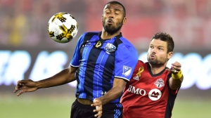 Montreal Impact forward Anthony Jackson-Hamel (24) battles for the ball with Toronto FC defender Drew Moor (3) during first half MLS soccer action in Toronto on Wednesday, September 20, 2017. THE CANADIAN PRESS/Frank Gunn