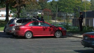 Police are shown at the scene after a child was pulled from a hot car in the Burnhamthorpe and Mill roads area.