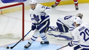 Toronto Maple Leafs defenceman Timothy Liljegren (78) saves the puck from going in the net as forward Dominic Moore (20) and goaltender Garret Sparks (40) look on during third period NHL preseason hockey against the Ottawa Senators in Ottawa on Monday, September 18, 2017. THE CANADIAN PRESS/Fred Chartrand