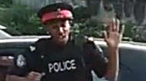 Toronto police are searching for a suspect after a west end collision was allegedly caused by a man accused of impersonating a police officer. (Toronto police)