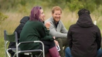 Britain's Prince Harry, centre, visits the Chatham Green Project, a conservation and educational initiative run by the Wilderness Foundation in Chatham Green, Essex, England, Thursday, Sept. 14, 2017.  (David Rose/Pool Photo via AP)