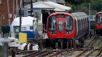 A police forensic tent stands setup on the platform next to the train on which a homemade bomb exploded at Parsons Green subway station in London, Friday, Sept. 15, 2017. Hundreds of London police embarked on a massive manhunt Friday, racing to find out who placed a homemade bomb on a packed London subway train during the morning rush hour. The explosion wounded people and caused a panicked stampede to safety. (AP Photo/Frank Augstein)