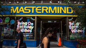 Pedestrians walk past a Mastermind Toys store on Queen St. East in Toronto on Tuesday, September 19, 2017. Mastermind Toys is shrugging off the challenges that have beset the retail sector with plans to open more stores this year. THE CANADIAN PRESS/Chris Donovan