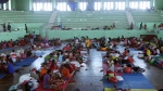 Villagers rest at a temporary shelter in Klungkung, Bali, Indonesia Saturday, Sept. 23, 2017. Thousands of villagers on the Indonesian resort island of Bali are sheltering in sports centers, village halls and with relatives, fearing Mount Agung will erupt for the first time in more than half a century. (AP Photo/Firdia Lisnawati)