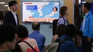 "People watch a TV news program reporting North Korea's earthquake, at Seoul Railway Station in Seoul, South Korea, Saturday, Sept. 23, 2017. South Korea's weather agency said an earthquake was detected in North Korea on Saturday around where the country recently conducted a nuclear test, but it assessed the quake as natural. The signs read "" The quake was detected in an area around Punggye-ri where the North conducted its sixth and most powerful nuclear test."" (AP Photo/Ahn Young-joon)"