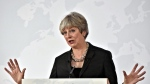 British Prime Minister Theresa May delivers her speech, in Florence, Italy, Friday Sept. 22, 2017. May tried Friday to revive foundering Brexit talks and unify her fractious government by proposing a two-year transition after Britain's departure from the European Union in 2019 during which the U.K. would continue to pay into the bloc's coffers. (AP Photo/Maurizio Degl'Innocenti, Pool)