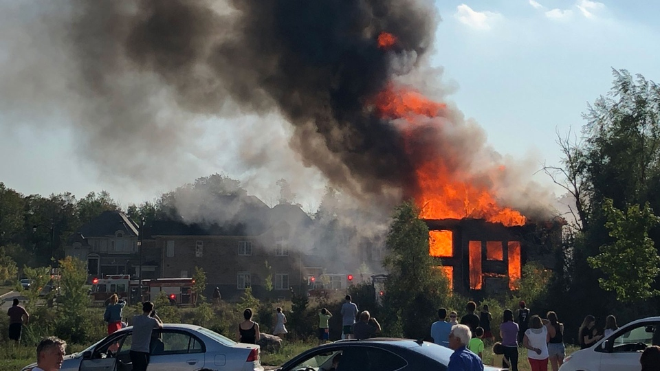 A fire rages at a home in Vaughan near Lady Valentina Avenue and Heintzman Crescent Saturday September 23, 2017. (@ballerinisswift /Twitter)