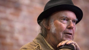 Canadian musician Neil Young speaks during a news conference in Vancouver, B.C., on Monday, November 23, 2015. Neil Young and Bruce Cockburn are among the latest inductees into the Canadian Songwriters Hall of Fame. Both musicians will join Montreal rock band Beau Dommage and French-Canadian composer Stephane Venne as the four artists honoured this year for their musical contributions. THE CANADIAN PRESS/Darryl Dyck