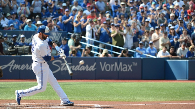 Toronto Blue Jays' Jose Bautista hits a single in front of an applauding crowd against the New York Yankees during the first inning of a baseball game Sunday, September 24, 2017 in Toronto. This may be Bautista's last home game as a Blue Jay. THE CANADIAN PRESS/Jon Blacker