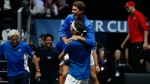 Europe's Roger Federer, down, celebrates with teammate Rafael Nadal, up, after defeating World's Nick Kyrgios during their Laver Cup tennis match in Prague, Czech Republic, Sunday, Sept. 24, 2017. (AP Photo/Petr David Josek)