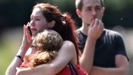 Kaitlyn Adams, a member of the Burnette Chapel Church of Christ, hugs another church member at the scene after shots were fired at the church on Sunday, Sept. 24, 2017, in Antioch, Tenn. (Andrew Nelles/The Tennessean via AP)
