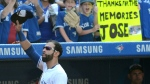 Toronto Blue Jays' Jose Bautista acknowledges the crowd after leaving the baseball game against the New York Yankees during the ninth inning, Sunday, September 24, 2017 in Toronto. THE CANADIAN PRESS/Jon Blacker