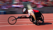 Kevin Nanson of the Canada races in the mens 100-metre dash IT4 wheelchair race final during the Invictus Games in Toronto on Sunday, September 24, 2017. THE CANADIAN PRESS/Nathan Denette