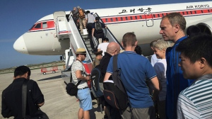 FILE - In this June 27, 2015, file photo, passengers board an Air Koryo plane bound for Beijing, at the Pyongyang International Airport in Pyongyang, North Korea. A proclamation President Donald Trump signed Sunday, Sept. 24, 2017, would suspend all immigrant and non-immigrant visas for North Koreans. But the measure is largely symbolic since most North Koreans in the U.S. are based at the United Nations and certain North Koreans are banned from traveling due to sanctions. (AP Photo/Wong Maye-E, File)