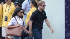 Prince Harry and his girlfriend Meghan Markle arrive at a wheelchair tennis event at the Invictus Games in Toronto, Monday, Sept.25, 2017. THE CANADIAN PRESS/Nathan Denette