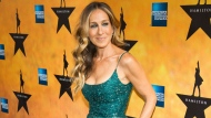 "In this Aug. 6, 2015 file photo, Sarah Jessica Parker attends the Broadway opening night of ""Hamilton"" in New York. Parker of ""Sex and the City"" fame will be taking four guests shoe-shopping at Bloomingdale's, then sending them to the New York City Ballet as part of an Airbnb launch of local tours and other experiences in New York. Parker's listing goes live Tuesday, with four spots at $400 each, first come first served. The money will benefit the New York City Ballet, where Parker is a board member. (Photo by Charles Sykes/Invision/AP, File)"