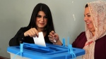 An Iraqi Kurdish woman casts her ballot during the referendum on independence from Iraq in Irbil, Iraq, Monday, Sept. 25, 2017. Iraq's Kurdish region vote in a referendum on whether to secede from Iraq. (AP Photo/Khalid Mohammed)