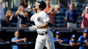 New York Yankees' Aaron Judge reacts after hitting a solo home run during the seventh inning of a baseball game against the Kansas City Royals at Yankee Stadium, Monday, Sept. 25, 2017, in New York. It was Judge's 50th home run, which sets a new record the most home runs hit by a rookie in the MLB. (AP Photo/Seth Wenig)