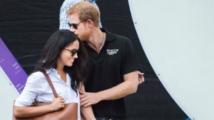 Prince Harry, right, arrives with his girlfriend Meghan Markle arrive to wheelchair tennis during the Invictus Games in Toronto on Monday, September 25, 2017. This is Prince Harry's first public appearance with Markle. THE CANADIAN PRESS/Nathan Denette