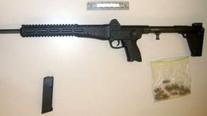 Toronto police say they seized a 9 mm semi-automatic firearm from a 16-year-old boy. (Toronto police)