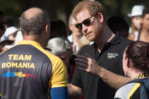 Prince Harry talks to a member of Team Romania during the Invictus Games m cycling event in Toronto on Tuesday September 26, 2017. THE CANADIAN PRESS/Chris Young
