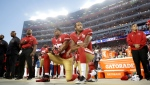 In this Sept. 12, 2016, file photo, San Francisco 49ers safety Eric Reid (35) and quarterback Colin Kaepernick (7) kneel during the national anthem before an NFL football game against the Los Angeles Rams in Santa Clara, Calif. What began more than a year ago with a lone NFL quarterback protesting police brutality against minorities by kneeling silently during the national anthem before games has grown into a roar with hundreds of players sitting, kneeling, locking arms or remaining in locker rooms, their reasons for demonstrating as varied as their methods. (AP Photo/Marcio Jose Sanchez, File)