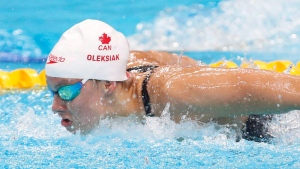 Canada's Penny Oleksiak competes in a women's 100-meter butterfly heat during the swimming competitions of the World Aquatics Championships in Budapest, Hungary, Sunday, July 23, 2017. World champion backstroker Kylie Masse and Olympic champion Oleksiak will lead Canada's swim team into the 2018 Commonwealth Games in Australia. THE CANADIAN PRESS/AP/Darko Bandic