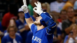 Toronto Blue Jays' Josh Donaldson celebrates his solo home run during the first inning of a baseball game against the Boston Red Sox in Boston, Tuesday, Sept. 26, 2017. (AP Photo/Michael Dwyer)