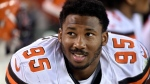 In this Aug. 10, 2017, file photo, Cleveland Browns defensive end Myles Garrett sits on the bench during the first half of an NFL preseason football game against the New Orleans Saints in Cleveland. (AP Photo/David Richard, File)